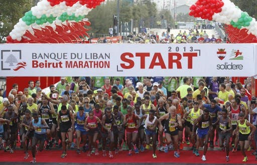 Participants start the 5km run during the 2013 Beirut Marathon on November 10, 2013 (AFP)