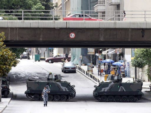 Lebanese soldiers stand guard on tanks on the fringe of a protest in Beirut on Sunday. AFP image for illustrative purposes.