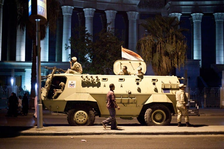 An Egyptian army armoured vehicle is seen in front of the Supreme Constitutional Court in Cairo ahead of planned demonstrations on August 18, 2013. (AFP)