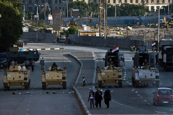 Egyptian army armoured personnel carriers (APC) are seen stationed in front of the Egyptian Museum in Tahrir Square on August 18, 2013 in Cairo. (AFP)
