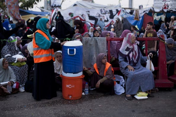 Supporters of deposed Egyptian President Mohammed Morsi wait prior to the 'iftar' fast-breaking meal at a sit-in protest at the Rabaa al Adweya Mosque in the Nasr City district on July 28, 2013 in Cairo. (Getty images)