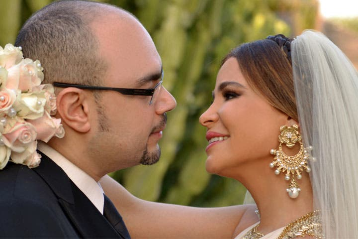 The happy couple: Waleed Mustafa and Carole Samaha on their wedding day. (Image: Facebook)