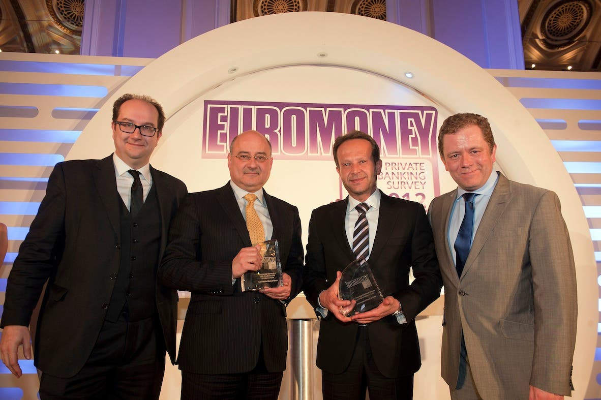 Chaouki Daker, Head of Private Banking at IBQ receiving the awards from Euromoney