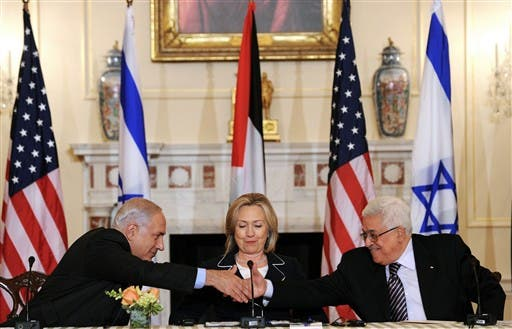 2010 US Secretary of State Hillary Clinton (C), looks on as Prime Minister Benjamin Netanyahu of Israel (L) and President Mahmoud Abbas of the Palestinian Authority (R) shakes hands as they re-launch of direct negotiations between Israeli and Palestinian Authority at the State Department in Washington, DC, on September 2, 2010