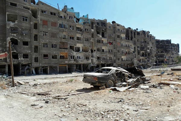 Buildings are heavily damaged in Zamalka, a suburb of the Syrian capital Damascus, shortly after troops loyal to Syrian President Assad launched a brutal offensive against rebels in the area. AFP/Shaam)