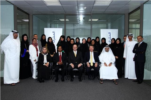 Douglas Beckett,  Head of Retail Banking Group - Mashreq, with the graduates in Abu Dhabi.