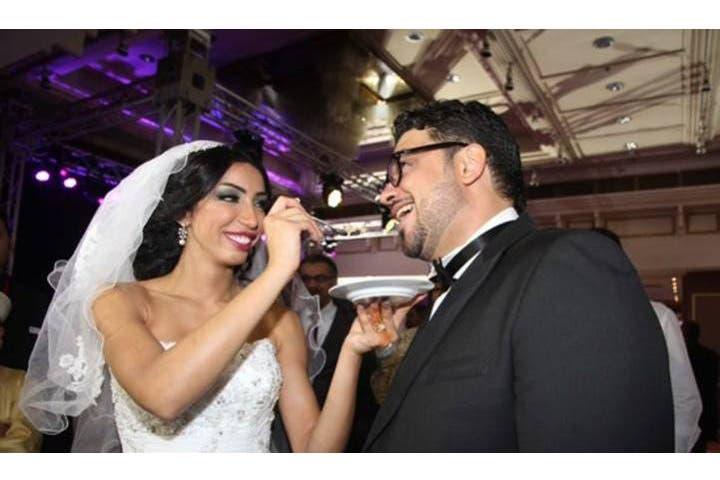 Dounia feeding cake to her new man on their wedding day. (Image: Facebook)