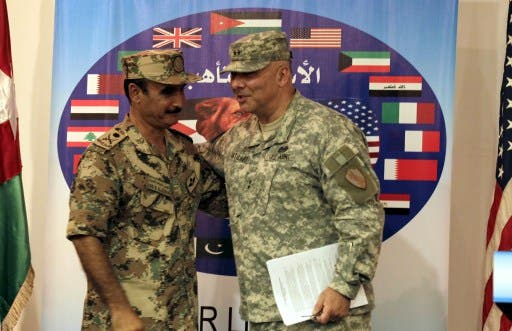 Operations Chief-of-Staff of the Jordanian armed forces Awni al-Adwan and US Major General Robert G. Catalanotti (R) are seen during a joint press conference announcing details about