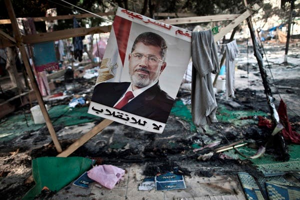 Morsi is planning on suing the Egyptian government over his ousting in July, his lawyers said Wednesday. (AFP/File)