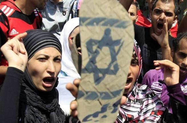 Protestors in Maadi, Cairo, yesterday