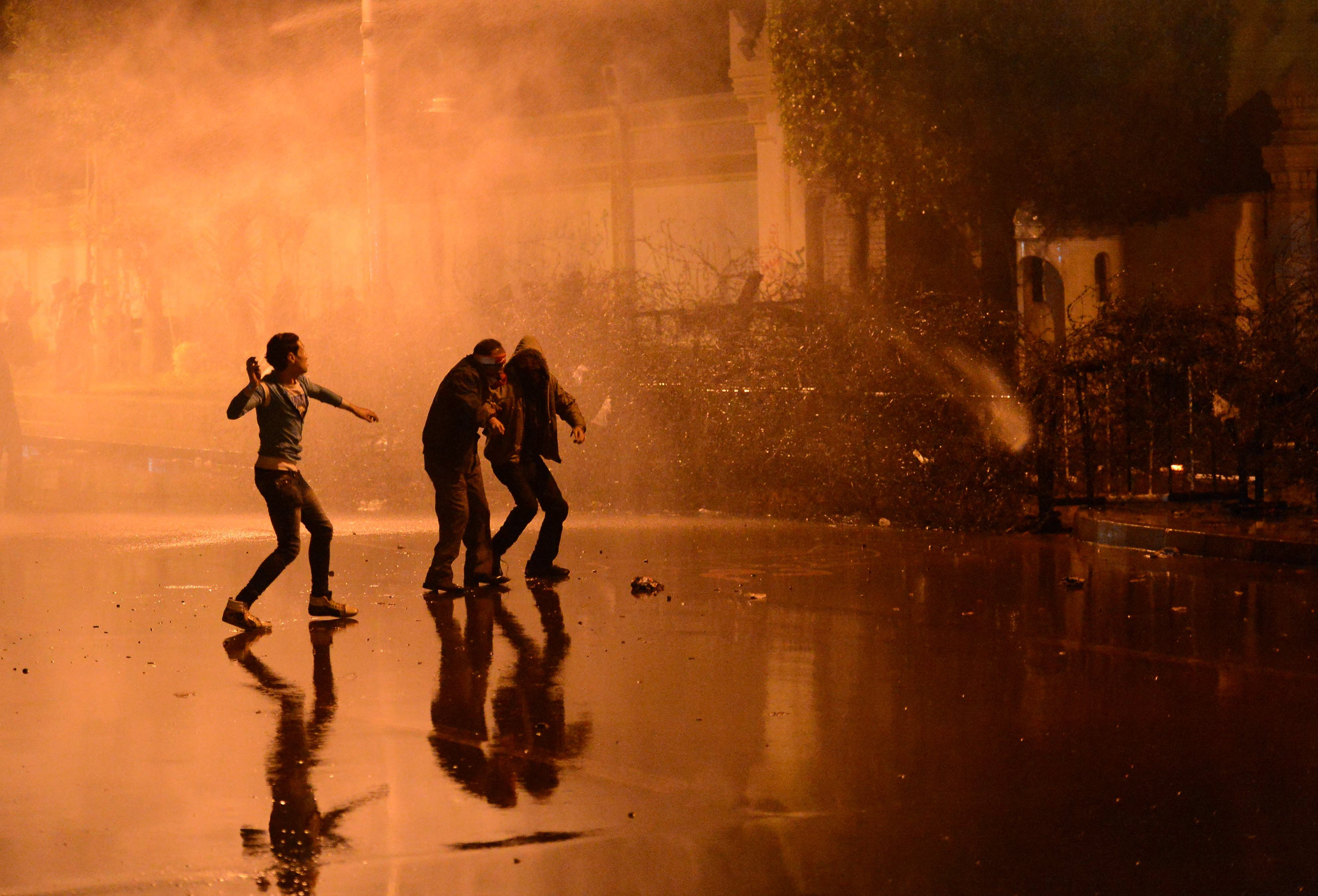 Egyptian police fired a water cannon at stone-throwing protesters outside the presidential palace on Monday as the opposition held rallies to mark the second anniversary of Hosni Mubarak's overthrow. (AFP)