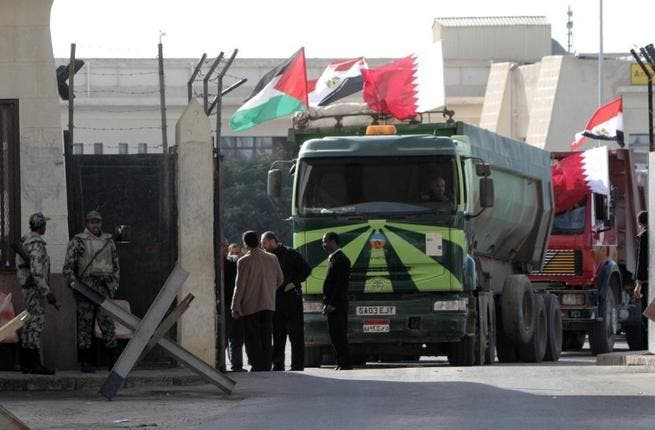 An Egyptian truck loaded with gravel prepares to enter through the Rafah border crossing, between Egypt and Gaza Strip, on Saturday. (AFP PHOTO / SAID KHATIB)