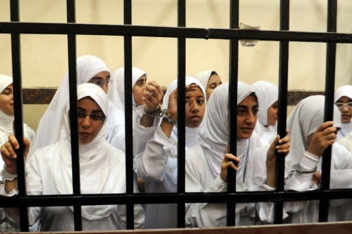 Female members of the Muslim Brotherhood are seen during their trial in the Egyptian city of Alexandria on November 27, 2013. Seven of the 21 arrested are aged between 15-17. (AFP)