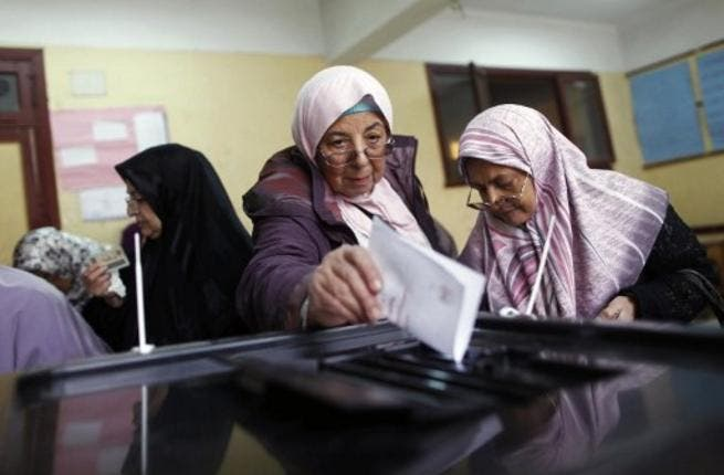 Egyptian women cast their votes in Cairo, for the referendum, 2012