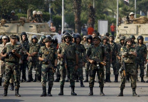 Egyptian army's soldiers stand guard in Cairo's eastern Nasr City district on October 11, 2013, as supporters of Egyptian ousted president Mohamed Morsi demonstrate against the military. (AFP)