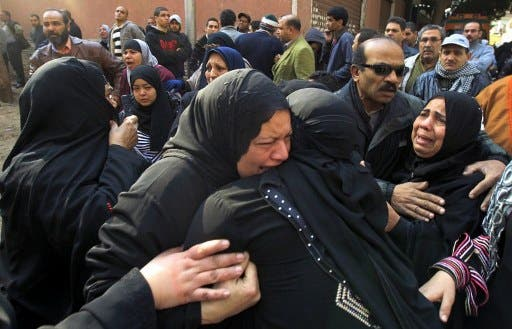 Egyptian women mourn at a morgue in Cairo.