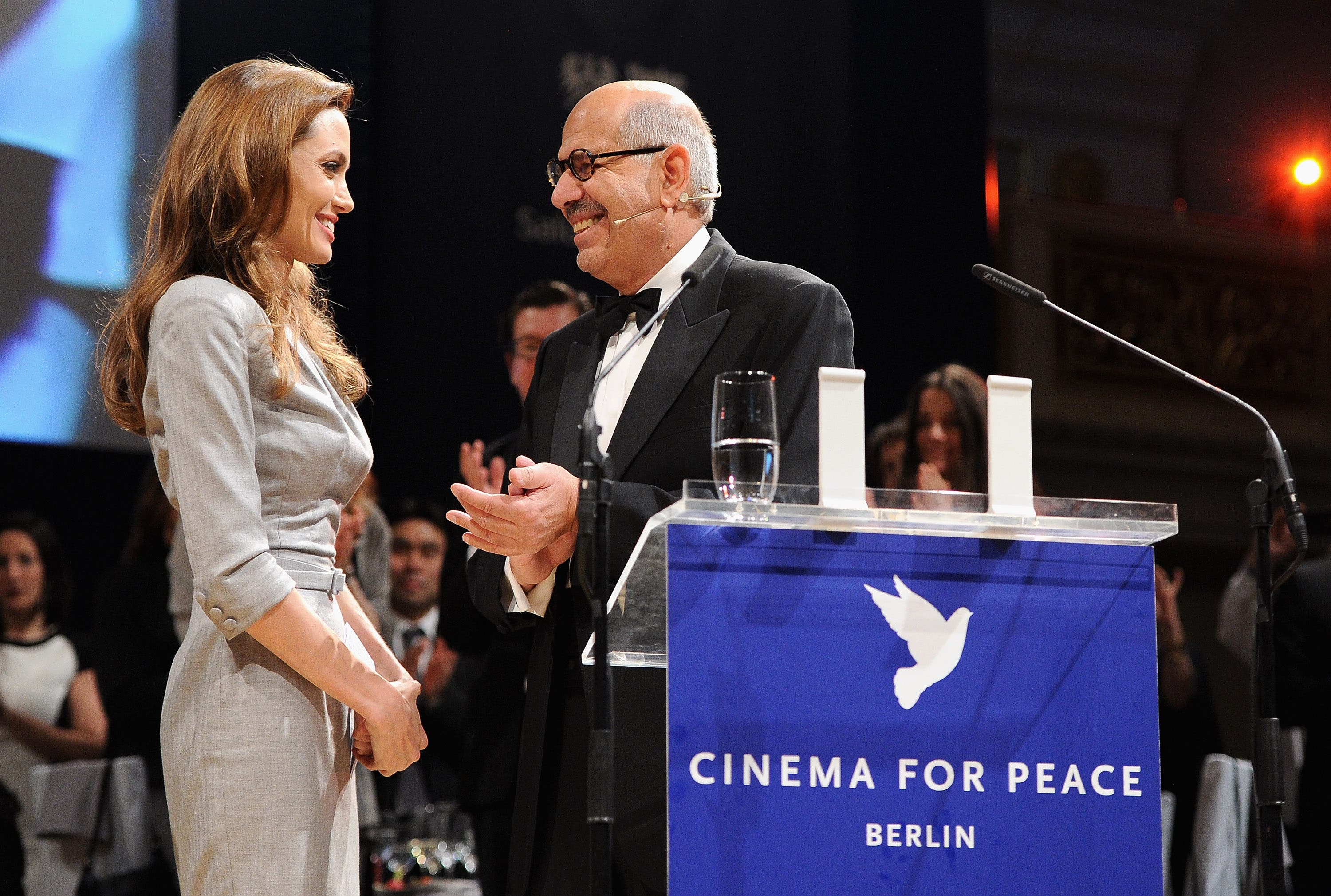 Mohamed ElBaradei and Angelina Jolie at the The Cinema of Peace Gala, where the famous kiss occurred.