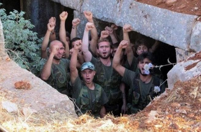 AFP PHOTO / HO / SHAAM NEWS NETWORK: FSA soldiers on a training exercise