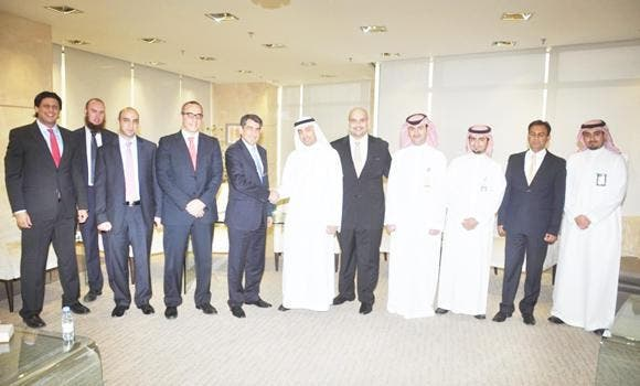 Emile Habib of Gulf Related with Yasir Abu Sulayman of NCB and senior executives.