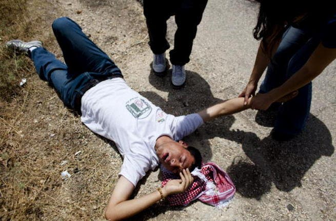 A Gaza teen falls, shot and injured by Israeli fire: Image used for illustrative purposes