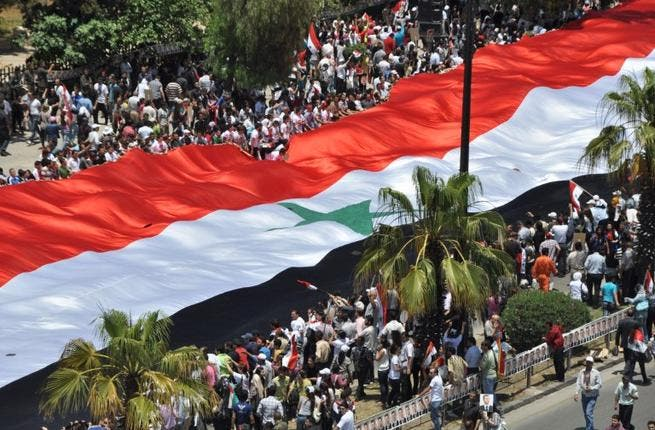 Pro-regime supporters rally in Damascus in 2011.