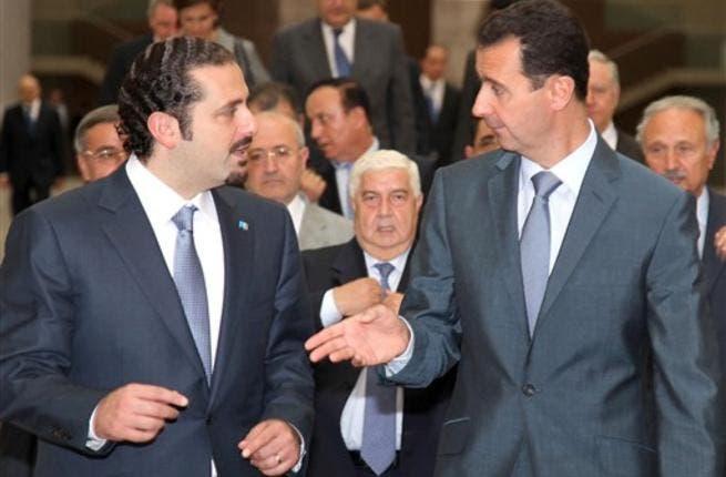 Former Lebanon Prime Minister Saad Hariri with Syrian President Bashar al-Assad.