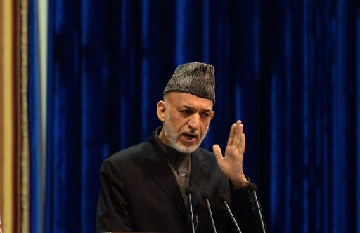 Top Afghan army official Brig. Gen. Abdul Raziq has spoken out against Hamid Karzai's (pictured) reluctance to sign a long-term security pact with the U.S., claiming that the president is emboldening the Taliban. (AFP/File)