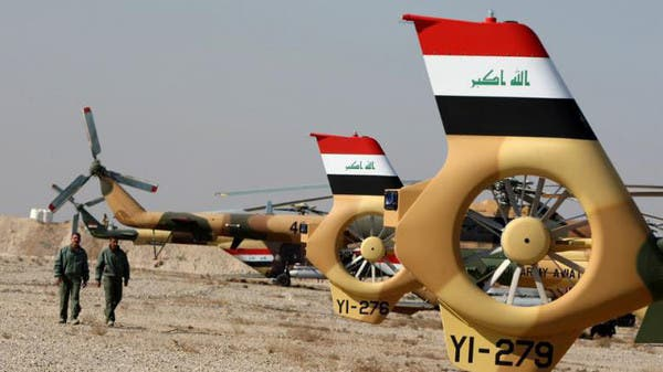 Four members of the Egyptian security forces were killed on Wednesday after the helicopter they were flying in was shot down by insurgents during a military training exercise north of Baghdad. (AFP/File)