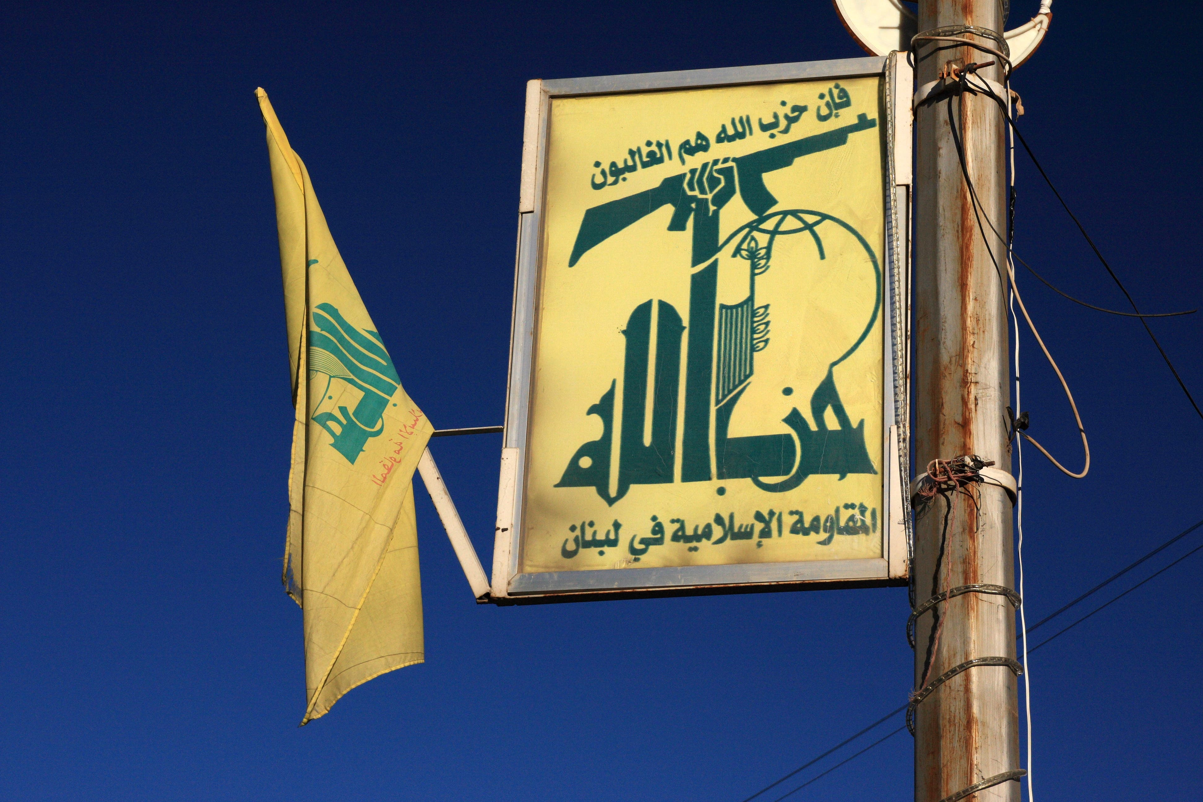 The Hezbollah flag is seen in the suburbs of Beirut. (AFP/File)