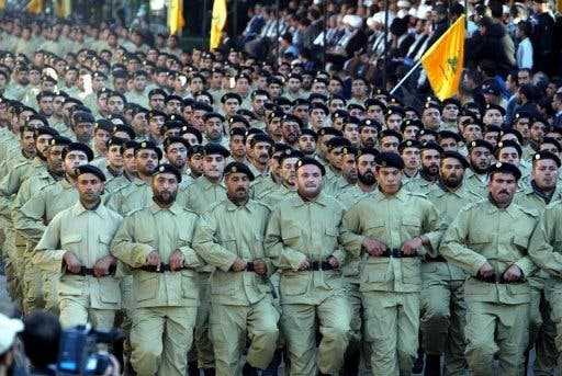 The Iranian Revolutionary Guards have trained more than 30,000 Hezbollah fighters since the 1980s, according to a recent report. (AFP/File)