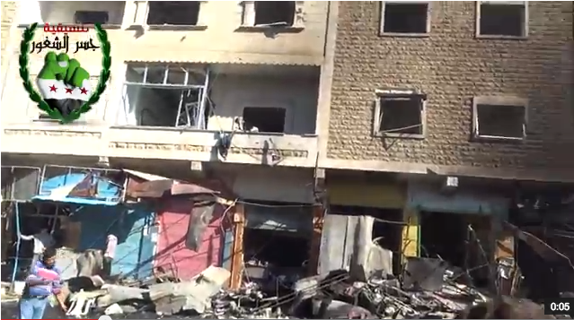 A shot of the damage in the popular Darkoush market shortly after the car bomb exploded. (YouTube/MiddleEastBrk)