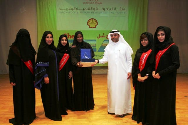 Omar Al Qurashi, Director of Communications at Shell with winners of BEA Award