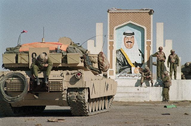 Pictured: the Iraqi invasion of Kuwait in 1990, which Iraq's new government is still paying the price for.