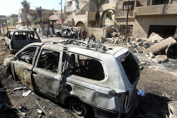 Iraqis inspect the aftermath of a suicide attack in Baghdad's eastern Al Jadidah district, on October 7, 2013. (AFP)