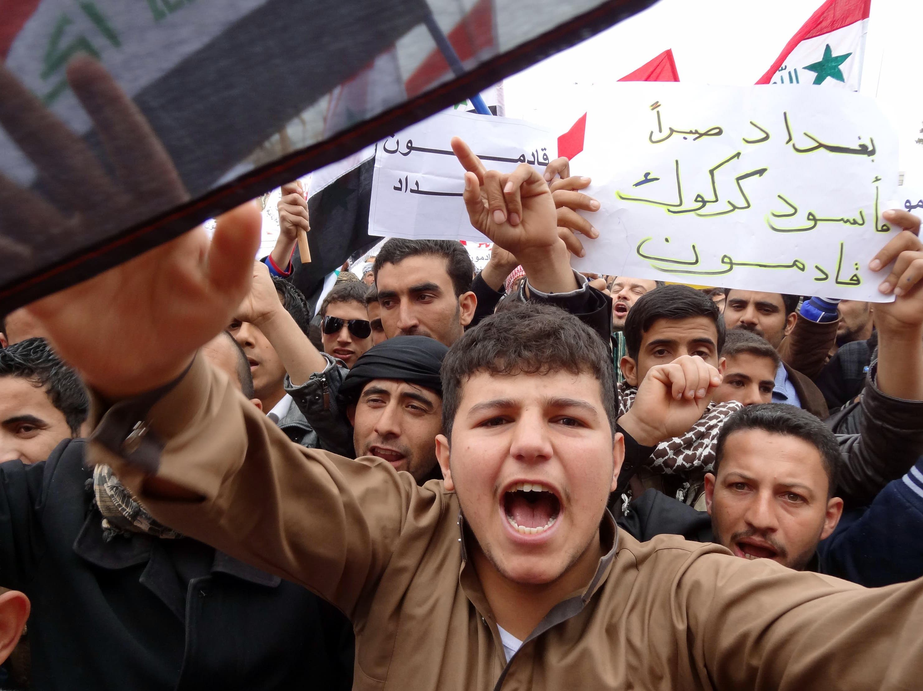 Iraqis shout slogans during an anti-government protest at the end of Friday prayers in the ethnically mixed city of Kirkuk,  north of Baghdad. Thousands of people in Sunni-majority areas of Iraq called for the government's fall amid a spike in violence that has accompanied a political stalemate two months before provincial polls. (AFP Photo/Marwan Ibrahim)