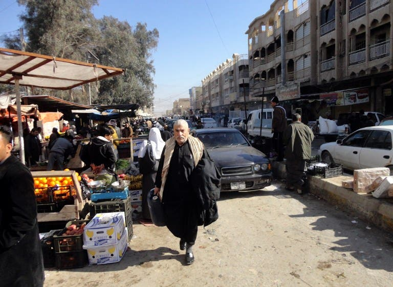 Despite the chaos engulfing Anbar province, life must go on as normal for many residents. Here, Iraqi traders sell their goods at an open air market in the center of the city of Fallujah, west of the capital Baghdad on January 8, 2014 (AFP)