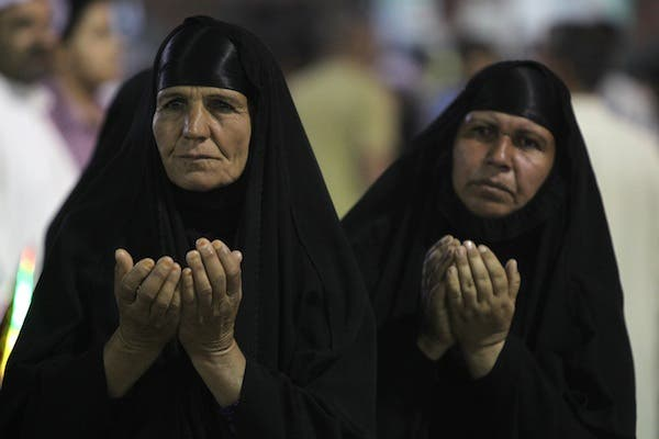 Muslim Shiites women pray during the ceremony commemorating the birth of Imam Mehdi, the 12th holiest figure for Shiite Muslims. in Karbala on Monday. Several bombs targeted Shiites on Monday evening, as sectarian violence grows. (AFP)