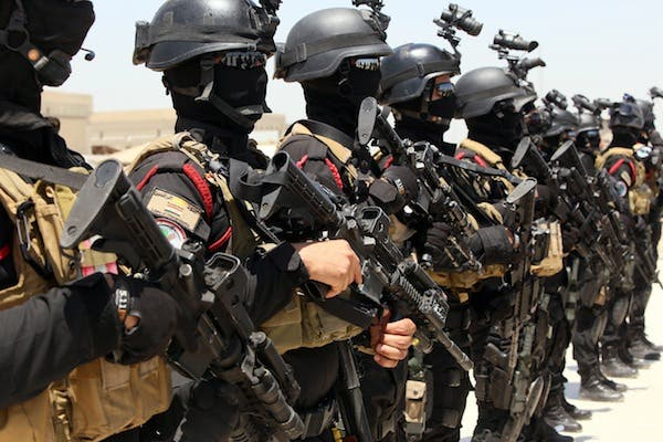 Iraqi special forces take part in a drill simulating a hostage rescue operation on Thursday at an Iraqi base in Baghdad. (AFP)