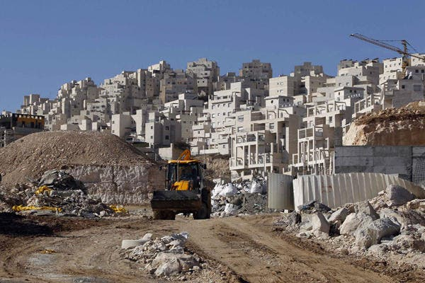 Internationally, Israel's settlements on Palestinian occupied land are considered illegal. In 2013, settlement building rose by 70 percent. (AFP/File)