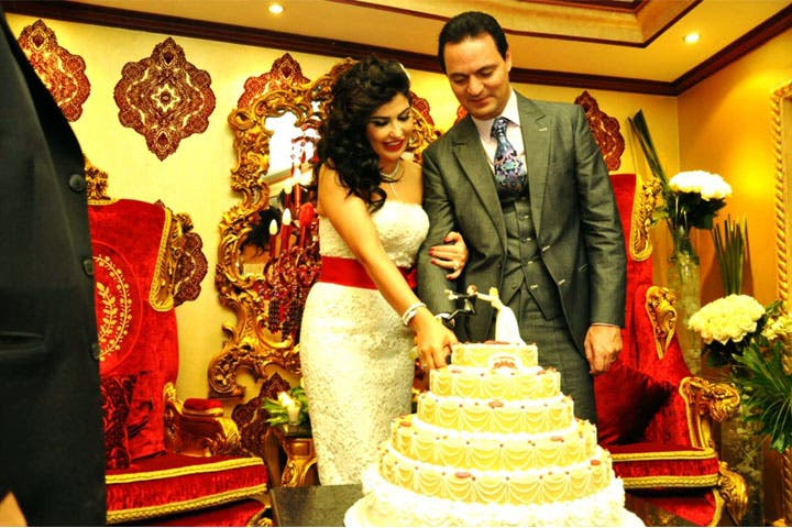 Cutting the cake: Jumana and Rabi married in an intimate ceremony last month. (Image: Facebook)