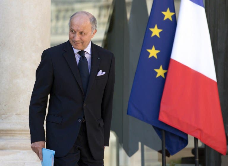 France's Foreign Affairs minister, Laurent Fabius leaves the Elysee Palace after the weekly cabinet meeting, on August 21, 2013 in Paris. (AFP)