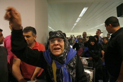 Long wait at the airport: relatives wait for pilgrims to arrive