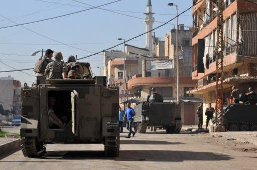 Lebanese army soldiers patrol a street in the northern Lebanese city of Tripoli on October 29, 2013 as army deployed following a week of clashes between supporters and opponents of Syria's regime.