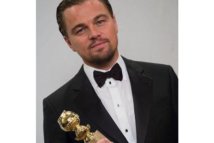 Leonardo DiCaprio with his award for