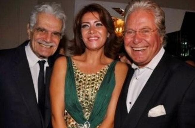 Hussein and ex-wife Liqa pose with legendary actor, Omar Sharif