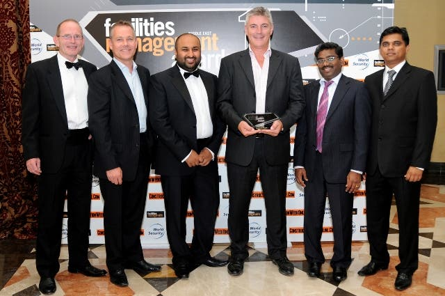 Ben Churchill, Managing Director of Emrill with other executives after receiving the award