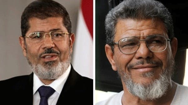 So close but yet so far: Security guards blocked a rendezvous between Egyptian President Mohamed Morsi (left) and his look-alike.