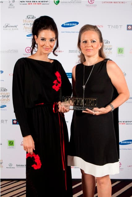 Larissa Kuzmina, Marketing Manager of Mauzan, receiving L'Officiel Middle East Arab Woman of the Year Award 2011