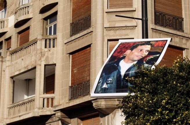 A photo of Mohamed Bouazizi floats about Avenue Bourghiba in Tunisia's capital.