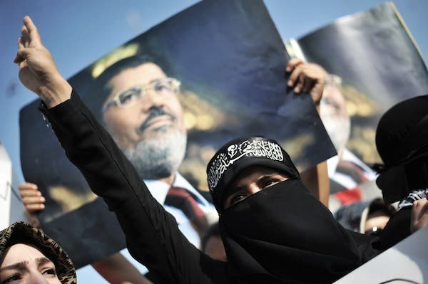 Morsi called on the Egyptian people to continue their revolutionary efforts, as he told the court that he is still the legitimate president of Egypt. (AFP/File)